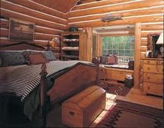 a woodsy retreat learn how designers are taking logs to new heights to create eclectic cabin decor this article has helpful decorating ideas - Cabin Bedroom Decorating Ideas