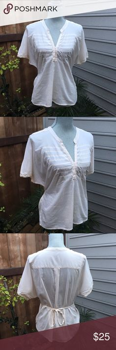 Vintage FREE PEOPLE Tee Vintage FREE PEOPLE Tee. Ivory cotton top with turn back. Clasps in front for chest coverage too. As is. In excellent condition. Free People Tops Tees - Short Sleeve