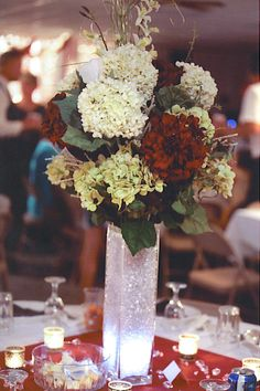 Wedding centerpiece. I like this style but with different flowers and colors