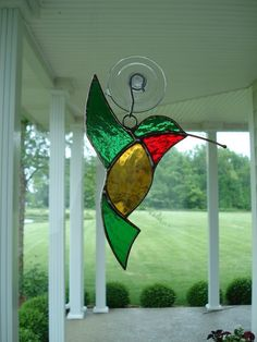 This stained glass hummingbird suncatcher was created by me in my Indiana studio. It is made using the Tiffany copper foil method of construction Stained Glass Ornaments, Stained Glass Birds, Stained Glass Suncatchers, Stained Glass Crafts, Faux Stained Glass, Stained Glass Designs, Stained Glass Panels, Stained Glass Patterns, Clear Ornaments