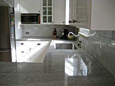 hampton carrara backsplash/kashmir white counters (involving home)