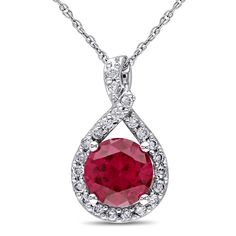 This fantastic necklace from the Miadora Collection features a round-cut created ruby stone and round white diamonds set in 10-karat white gold. This brilliant pendant is hung on a rope chain and is secured with a spring ring clasp.