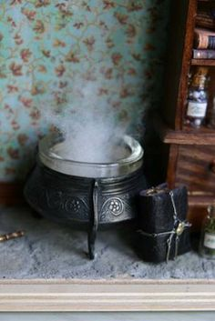 """cauldron with batting as """"steam"""" i want to use this steam for a bathroom"""