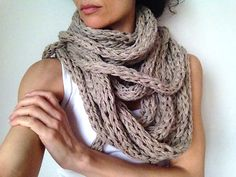 CAMEL COLOR INFINITY SCARF  We love this one. We made one for ourself and we keep wearing it. It is so easy to match and wear with casual or more formal clothes, for both of us.  The color is camel beige with some darker and lighter flecks which give an interesting texture to the yarn. Its natural look and lightness are great!  Tight to the neck or the wild way, you can change every day. You decide! The scarf is joined as a big loop - measuring about 29 feet long in total !! Be ready to play…