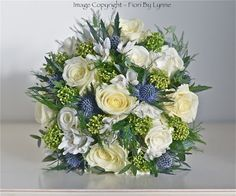 Ivory roses and thistle bouquets