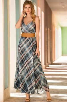 """Wrap yourself in our effortless plaid print maxi dress with double shoulder straps, inside tie and wrap button closure. Self-tie sash included; lined skirt.• Polyester.• Imported.• Dry clean.• Effortless: easy fit with slight shaping.• Maxi: 57""""-58"""".• Sizes XXS(0), XS(2-4), S(6-8), M(10-12), L(14-16), XL(18)."""