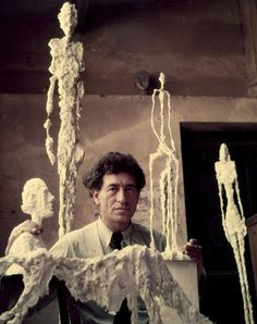 ALBERTO GIACOMETTI, Giacometti in his studio with plaster models, 1952. Photography by Gordon Parks (The LIFE Picture Collection/Getty Images). / Biography