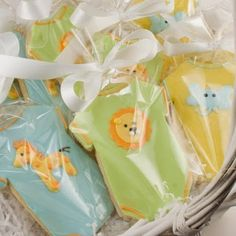 Cute little cookies cut out in the shape of a onesie and decorated with adorable critters!