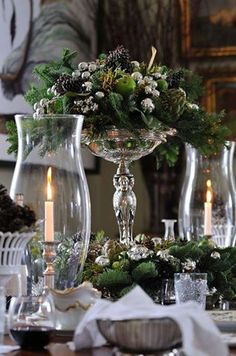 Christmas kitchen: Greenery, fruit, & pinecones mounded atop a pedestal server. An idea for my tall crystal pedestal cake plate or some of my vintage silver plate server pieces. ~ Splendid Sass: STUNNING TABLESCAPES by pauline Christmas Tablescapes, Christmas Centerpieces, Christmas Decorations, Holiday Decor, Christmas Candles, Christmas Buffet Tablescapes, Silver Centerpiece, Winter Christmas, All Things Christmas