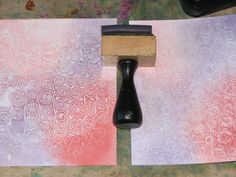 Wax Paper Resist - #2 - Faux Embossing Resist - put wax paper in an embossing folder, run through Cuttlebug, Sandwich wax paper between 2 sheets of card stock and iron.  Then apply ink (like Distressed Ink) to a ink blending tool and apply to cardstock.  Ink will not stick to the wax.