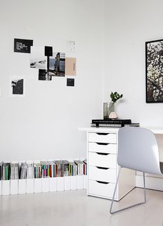 simple white workspace | AMM blog // the magazine holders all across the floor omgggg brilliant