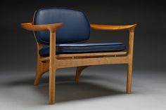 The Social Chair is a lounge chair made of domestic cherry, leather and brass. It is available for purchase by commission, allowing for a custom choice of wood species and fabric.