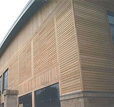 Siberian Larch cladding from Vincent Timber, suppliers of all types of wood throughout the UK and are specialists in Siberian larch cladding. Larch Cladding, Exterior Cladding, Siberian Forest, Types Of Wood, Blinds, Facades, Outdoor Decor, Centre, Garage