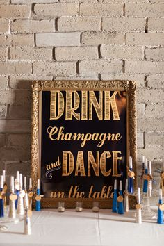 Drink champagne and dance on the tables! photo by Blue Rose Photography http://ruffledblog.com/seattle-new-years-eve-wedding #weddingsign #gold