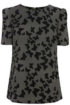 We're in love with this silhouette butterfly print this season and this pretty top is a wardobe must have. The piece features cap sleeve styling and a crew neckline. The top is finished with an exposed zip fastening on the reverse.