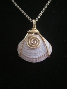 Wire wrapped around a shell pendant, the possibilities are endless with this and all my shells #wirejewelry