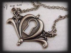PEEKING, antique silver key hole necklace