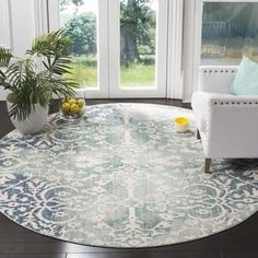 Shop for Safavieh Mystique Watercolor Blue/ Ivory Distressed Silky Polyester Rug (6' 7 Round). Get free shipping at Overstock.com - Your Online Home Decor Outlet Store! Get 5% in rewards with Club O! - 21183790
