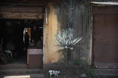 Lotus Blossoms by Sprout on the Streets of Goa, India South African street artist is attracted to the lotus flower because of its strength. It is a plant that must fight through mud and water before it can blossom on top of its high stalk . Reverse Graffiti, South African Artists, Colossal Art, Fruit Art, Street Signs, Land Art, Street Artists, Art Images, Paper Art