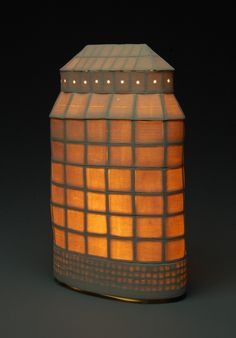 Water Tower by Jonathan White. Hand built Porcelain frame covered with thin sheets of porcelain. Fired to maturity unglazed. Illuminated with one 23 watt bulb. Rayon covered cloth cord with inline switch.