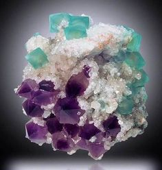 Green Fluorite with Amethyst on Calcite.