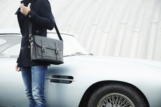 Discover the British made Winster Messenger bag alongside the Aston Martin DB4 at www.acassi.co.uk  Made from Leather and Harris Tweed.