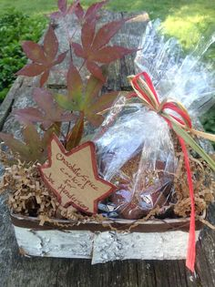 To deliver my sweet bribe I wrapped the cookies in cellophane tied with ribbon in fall colors.  I nestled the cookies in a birch bark box filled with shredded paper.  I made a tag using corrugated cardboard that I traced with the cookie cutter, cut out  and then outlined in rust marker.