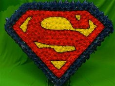 Superman Logo Funeral Tribute- could use flowers instead?