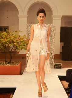 White georgette jacket dress (INR 7500) worn with silver shimmer-sea shorts (INR 2290)