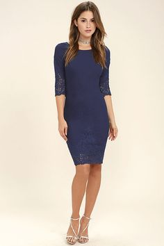 The Midnight Garden Navy Blue Lace Bodycon Dress is stunning, even after the clock strikes twelve! Sleek, stretch knit makes it's way across a bateau neckline, three-quarter sleeves, and a low-dipping back. Darting and seamed detail creates a tailored fit, while elegant pierced lace embellishes the bodycon skirt and sleeves. Hidden back zipper/clasp.