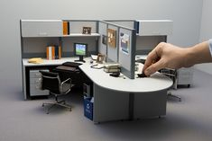 Reduced model office | Flickr - Photo Sharing! An NRC researcher adjusts a detail on a one-sixth scale model of a typical office cubicle.
