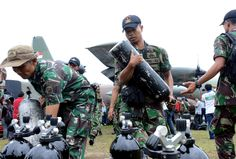 Search for bodies from AirAsia flight - Dewi Nurcahyani/AP Photo