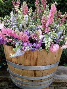 Put this in the front yard filled with snapdragons. barrel planter - love love love snapdragons!