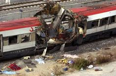 At least 170 people are killed after powerful explosions tear through three Madrid train stations during the morning rush-hour. Guernica, Ray Charles, Train Station, Memorial Day, Recreational Vehicles, Madrid, Monster Trucks, In This Moment, History