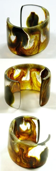 Marbled color swirls in this semi-translucent resin bangle.