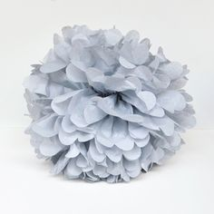 A tissue paper pompon to hang up and decorate your birthday party