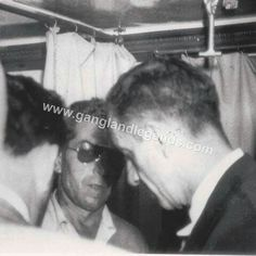 1947, Lucky Luciano exiled from Cuba, headed back to Italy. Candid photo of Lucky being questioned by police, on board the Turkish freighter Bakir. HE LOOKS FUCKING MAD ahaha