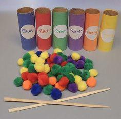 Купите маленькие пумпончики (магазин рукоделия или детского творчества). Возьмите втулки от туалетной бумаги и сделайте на них наклейки тех цветов, которые есть в наборе пумпончиков. Задача ребенка - вложить щипцами пумпончики в подходящие втулки.