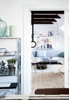 A danish home with amazing style - see more pictures form this om on the blog. Here you get a look at the livingroom from the dining room.