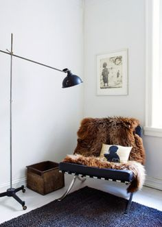 Faux fur over a reading chair. reading nook. barcelona #chair, scandinavian #interiors simple white home decor