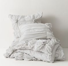 RH TEEN's Gathered Knot Duvet Cover:Love knots. Whisper-soft cotton voile is gathered and tied by hand into romantic rosettes, each framed by windowpane quilting. Our signature cotton percale lines the back, adding a touch of weight for a graceful drape.
