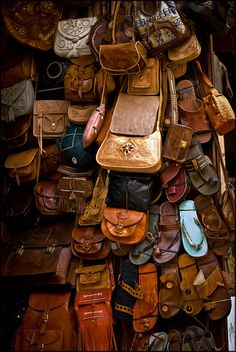 Leather bags & slippers at the souk  in the Fez Medina, Morocco by Kimberly Jansen, via Flickr