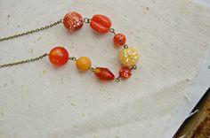 Orange Whimsical Necklace : OJ. $35.00, via Etsy.