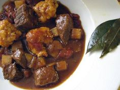 Gulyasleves (hungarian Goulash)    This hearty and traditional goulash is filled with chunks of beef, tomatoes, potatoes, Hungarian sweet paprika, and topped with soft and tender egg dumplings.