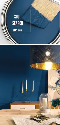 The dark blue hue of Soul Search by BEHR Paint is just what your home needs. This chic dining room uses metallic gold accents to complement the bold wall color. Light wood furniture completes the stylish look. Learn more by clicking here. by tamara Color Palette For Home, Paint Colors For Home, House Colors, Behr Paint Colors, Design Seeds, Boho Home, Natural Home Decor, Blue Home Decor, Blue Wall Decor