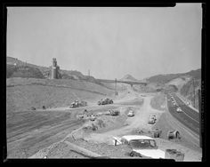 SHERMAN OAKS:  San Diego Freeway under construction across the Santa Monica Mountains, facing south.  The Mulholland Drive bridge can be seen in the distance and Sepulveda Boulevard is on the right, 1961.