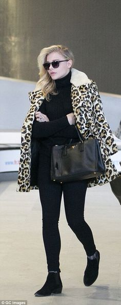 Chloe Grace Moretz wore an all-black outfit but adding a touch of drama with a leopard print coat by Coach