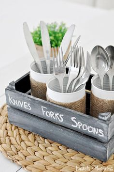 DIY wooden silverware caddy using upcycled tin cans. A quick and easy tin can craft that you can make in minutes. A great to upcycle old tins cans and an great kitchen organization idea.