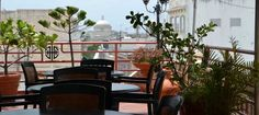 """Hotel Milano Penthouse Terrace  NYT 36 hours """" Have a Cuba libre (rum, coke, wedge of lime) at Old San Juan's only rooftop restaurant, the Panorama Terrace Bar and Latin Grill at Hotel Milano (307 Calle Fortaleza; 787-729-9050), as the sun goes down and the lights of San Juan and the cruise ships flicker to life. Across the bay are the lights of Caparra, site of Ponce de León's first settlement."""""""