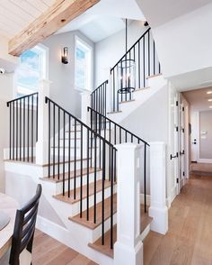 Industrial with a mix of comfort for this wrought iron wood stairwell!